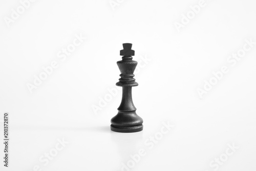 Black king chess piece in white isolated background Fotobehang