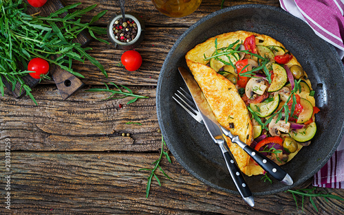 Omelet with tomatoes, zucchini and mushrooms. Omelette breakfast. Healthy food. Top view. Flat lay