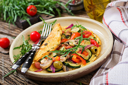 Omelet with tomatoes, zucchini and mushrooms. Omelette breakfast. Healthy food.