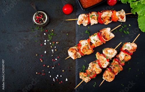 Chicken skewers with slices of sweet peppers and dill. Tasty food. Weekend meal. Top view. Flat lay.