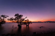Long exposure image of Dramatic color sky seascape with reflection in sunset or sunrise scenery nature for background.