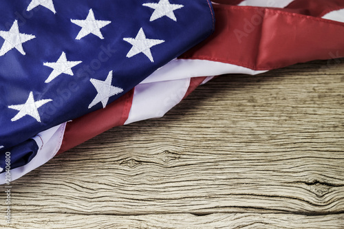 Poster Countryside American flag on wood background with copy space