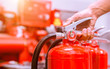 canvas print picture - Close up Fire extinguisher and pulling pin on red tank.