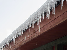 Icicles On The Roof Of The Cottage