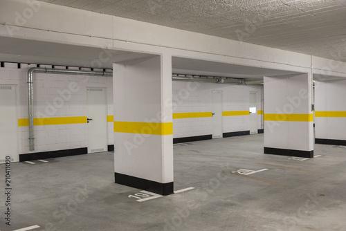 Typical underground car parking garage in a modern apartment house Plakát