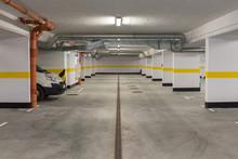 Typical Underground Car Parking Garage In A Modern Apartment House.