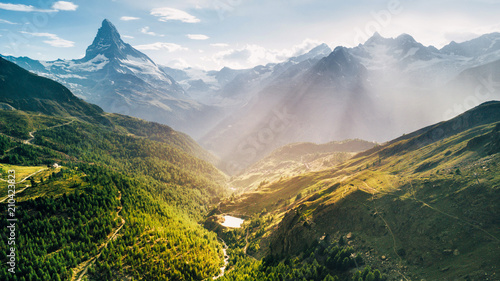 Matterhorn Mountain epic aerial view with white snow and blue sky in n Switzerland