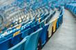 empty colorful seats on tribunes of modern stadium