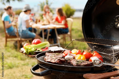 Modern grill with meat and vegetables outdoors, closeup
