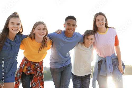 Photo Group of children outdoors on sunny day. Summer camp