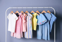 Rack With Stylish Child Clothe...