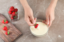 Woman Dipping Ripe Strawberry ...