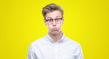 Young Handsome Blond Man Puffing Cheeks With Funny Face. Mouth Inflated With Air, Crazy Expression.