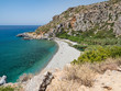 Beautiful Preveli Beach in Crete island. There is a palm forest and a river inside the gorge near this beach. Greece, june, 2018