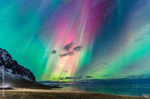Colorful northern lights over iceland sky
