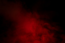 Red Smoke On A Black Background