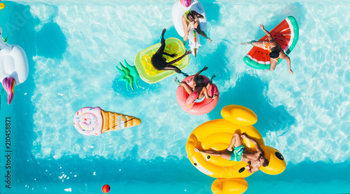 group of friends having fun in the swimming pool Fototapeta