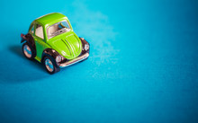 Green Toy Car On Blue Background
