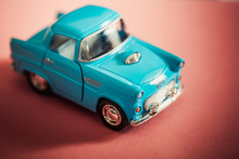 Blue Toy Car On Red Backgroud