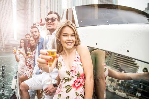 Obraz na plátně  Group of friends making party on a yacht in Dubai