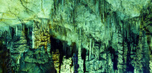 Inside Natural Cave That Has A Lot Of Stalactite In The Dark
