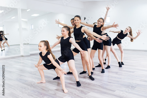 fototapeta na ścianę The group of beautiful teenage girls practicing modern ballet dance.
