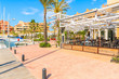 Beautiful Sotogrande marina with colorful houses and palm trees on coastal promenade, Costa del Sol, Spain