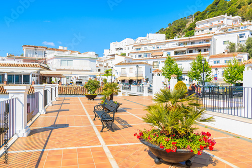 Fototapeta Terrace with white houses in picturesque village of Mijas, Andalusia, Spain