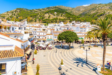 MIJAS VILLAGE, SPAIN - MAY 9, 2018: Main Square With Houses In Picturesque White Village Of Mijas, Andalusia. Southern Spain Is Famous For Mountain Villages With White Architecture.
