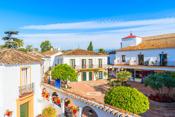MARBELLA, SPAIN - MAY 7, 2018: View of apartment hotel with typical architecture of small Spanish village. Andalusia is the only European region with both Mediterranean and Atlantic coastlines.