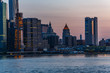 Manhattan skyline, sunset in New York