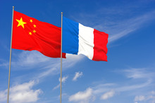 China And France Flags Over Blue Sky Background. 3D Illustration