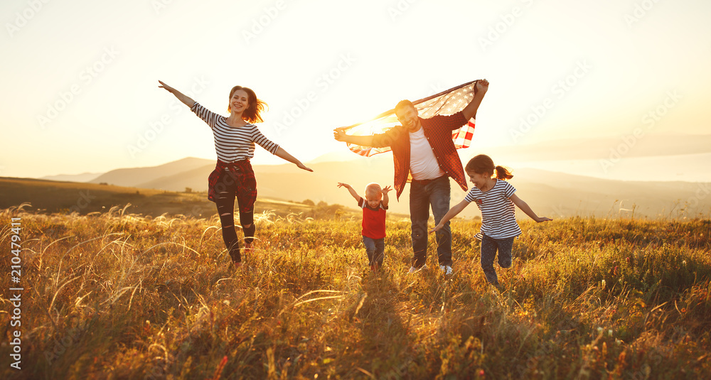 Fototapety, obrazy: happy family with flag of america USA at sunset outdoors