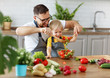 happy family father with son preparing vegetable salad