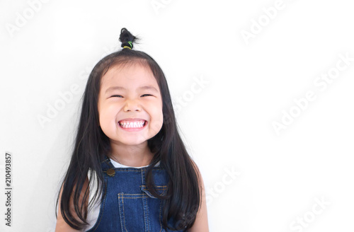 Vászonkép Asian children cute or kid girl and kindergarten student happy smile white teeth