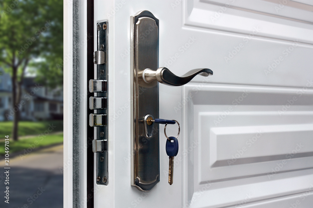 Fototapety, obrazy: Open door of a family home. Close-up of the lock with your keys on an armored door. Security.