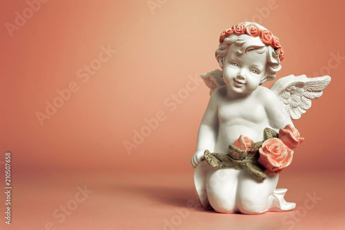 Little cherub holding flowers Wallpaper Mural