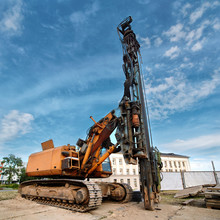 Hydraulic Crawler Pile Driving Rig Machine Standing Near The Construction Site And Ready For Work. Heavy Construction Machinery.