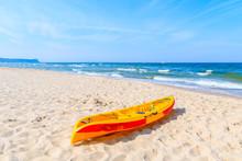 Red And Yellow Color Kayak On Sandy Beach In Goehren Summer Resort, Ruegen Island, Baltic Sea, Germany