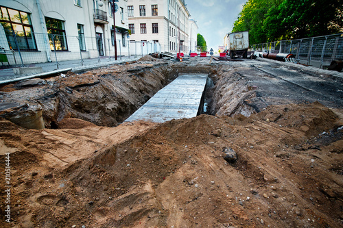 Valokuvatapetti Ruined asphalt and pit excavated to replace old pipes