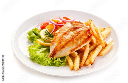 Grilled chicken fillet, chips and vegetable salad