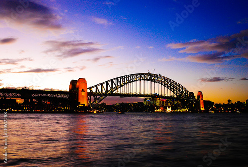Mighty construction of harbor harbour bridge during sunset sky to downtown city center centre Sydney for holiday and couple romantic honeymoon © BISURJADI