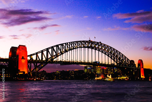 Staande foto Sydney Mighty construction of harbor harbour bridge during sunset sky to downtown city center centre Sydney for holiday and couple romantic honeymoon