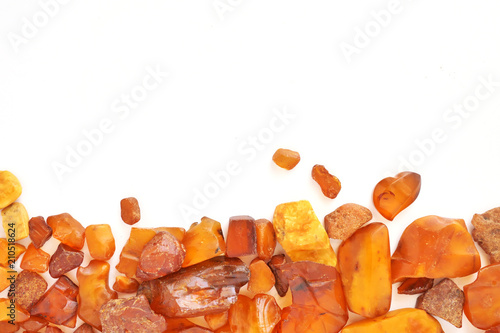 Natural raw amber stone isolated on white background. Fotobehang