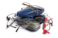Used Spectacles And Cases On A White Background