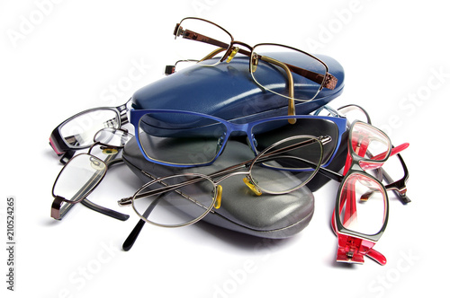 used spectacles and cases on a white background Fototapeta