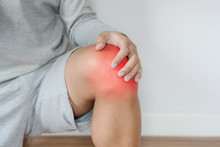 A Man Touching Knee With Red Highlights Concept Of Knee And Joint Pain