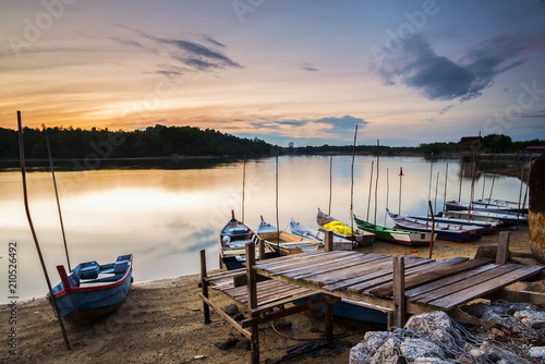 Staande foto Athene Sunrise Scenery at Lumut Bay,Perak,Malaysia with Resting Boat. Soft focus,Blur due to Long Exposure.
