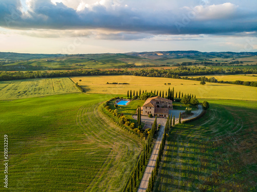 Deurstickers Toscane Beautiful landscape scenery of Tuscany in Italy - cypress trees along white road - aerial view - close to Pienza, Tuscany, Italy