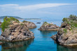 Rock islands in the blue sea with boats - summer holidays